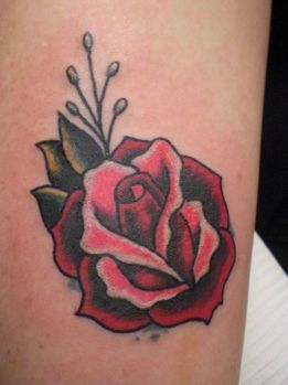 tattoo picture of traditional rose tattoo with minimal color use