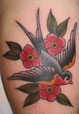 traditional swallow tattoo bold lines minimal color